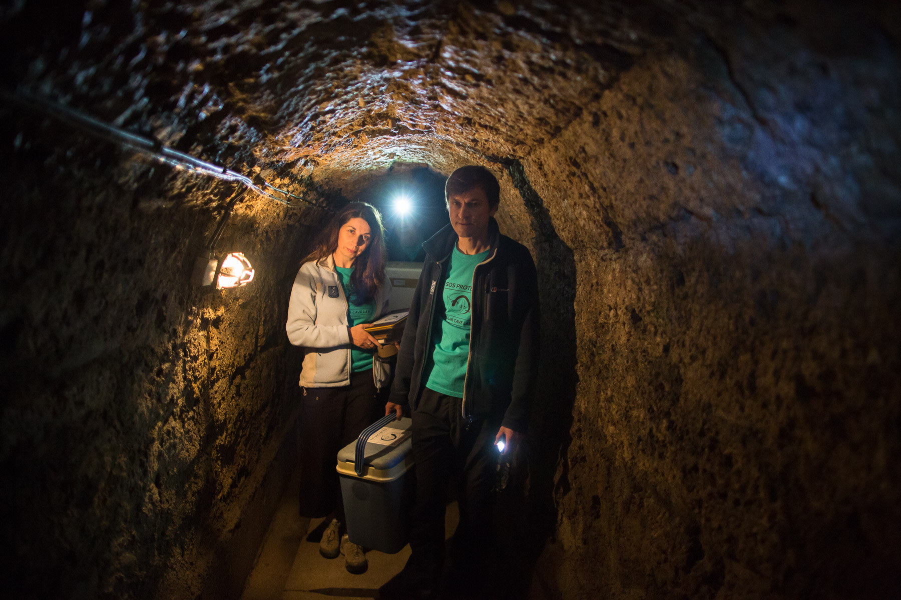Gregor Aljančič and Magdalena Năpăruş-Aljančič exit Tular Cave Laboratory by way of a concrete tunnel.