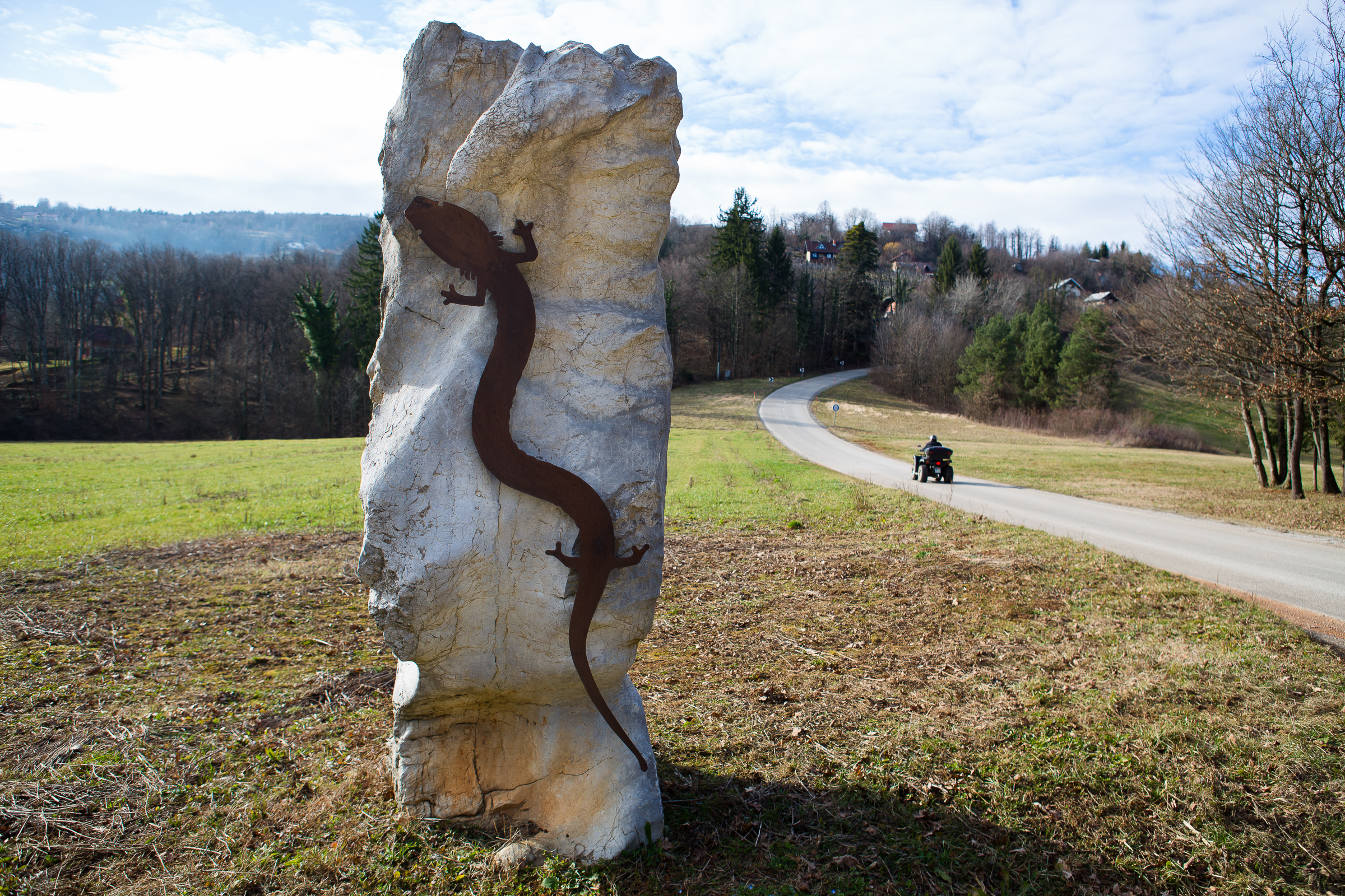A sculpture marks a country road that leads to one of the springs where the black olm lives.