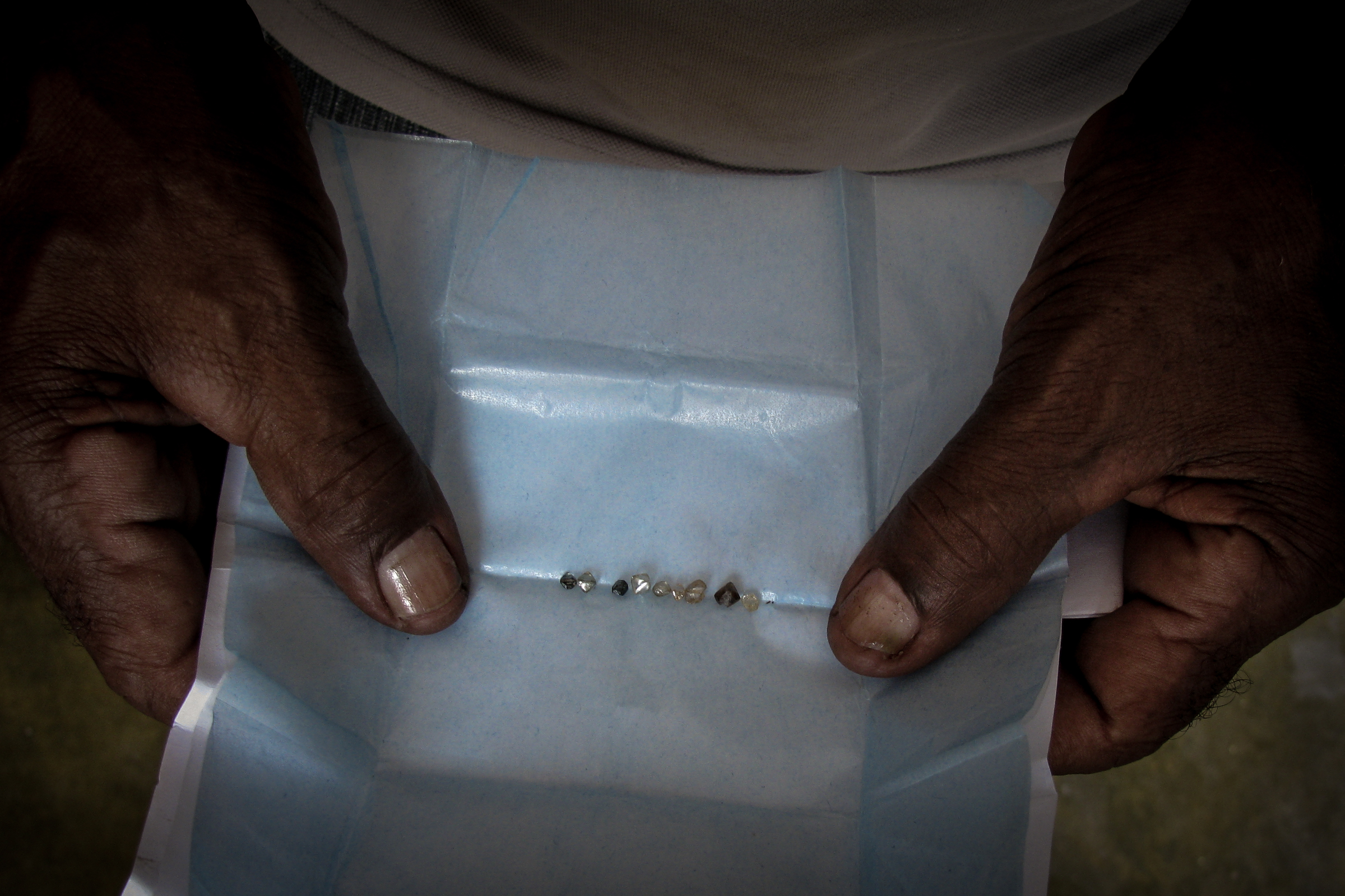 A miner displays a haul of diamonds extracted from streams in Chapada Diamantina, Bahia State using the same methods his ancestors used more than two centuries ago. These mining traditions have had an impact on the Campo Rupestre but may themselves be affected by large-scale development.