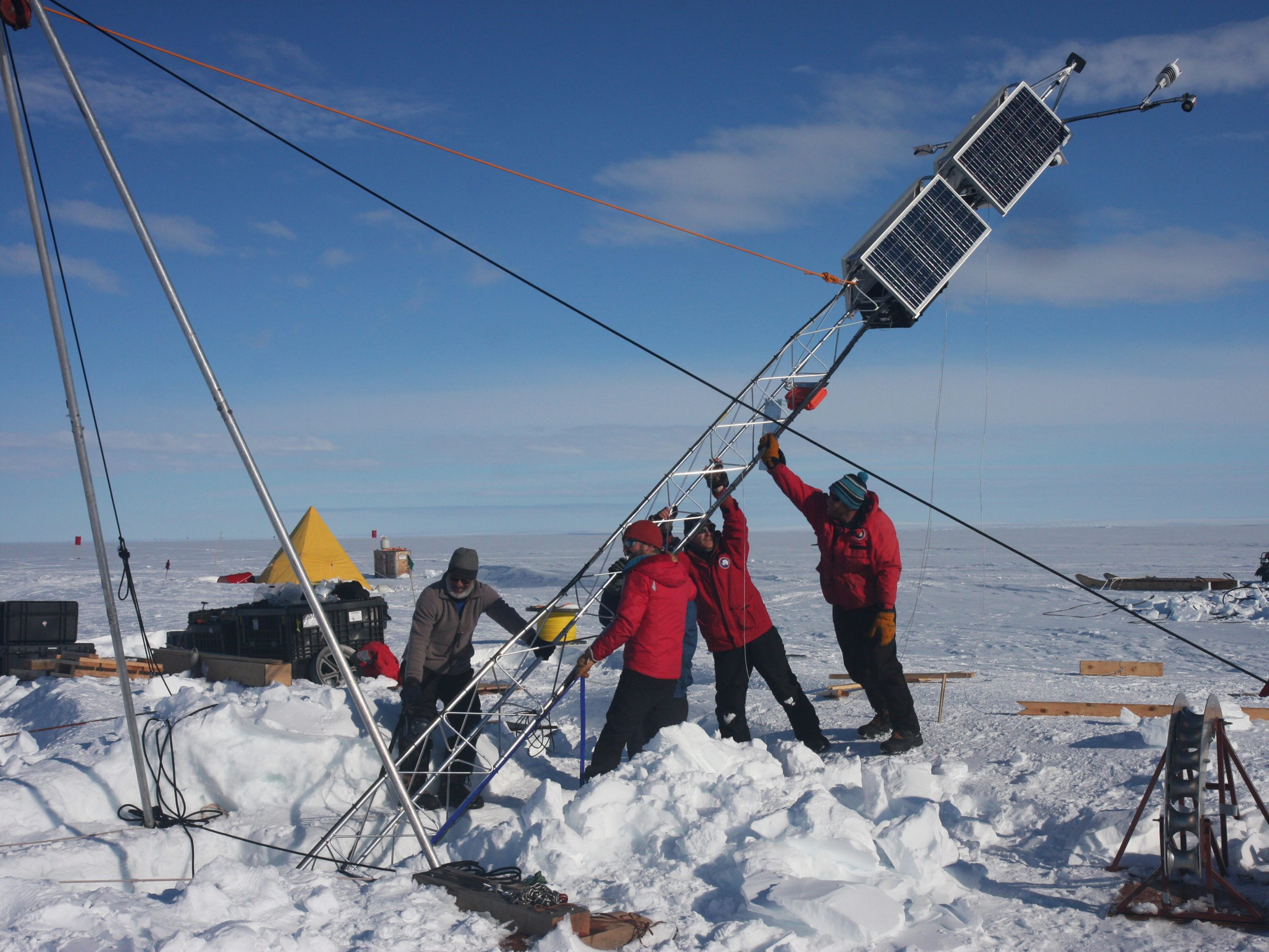 After instruments were lowered through a hole in the Thwaites Ice Shelf, a tower was raised to collect weather observations and to transmit data back home, via satellite. Photograph by Douglas Fox