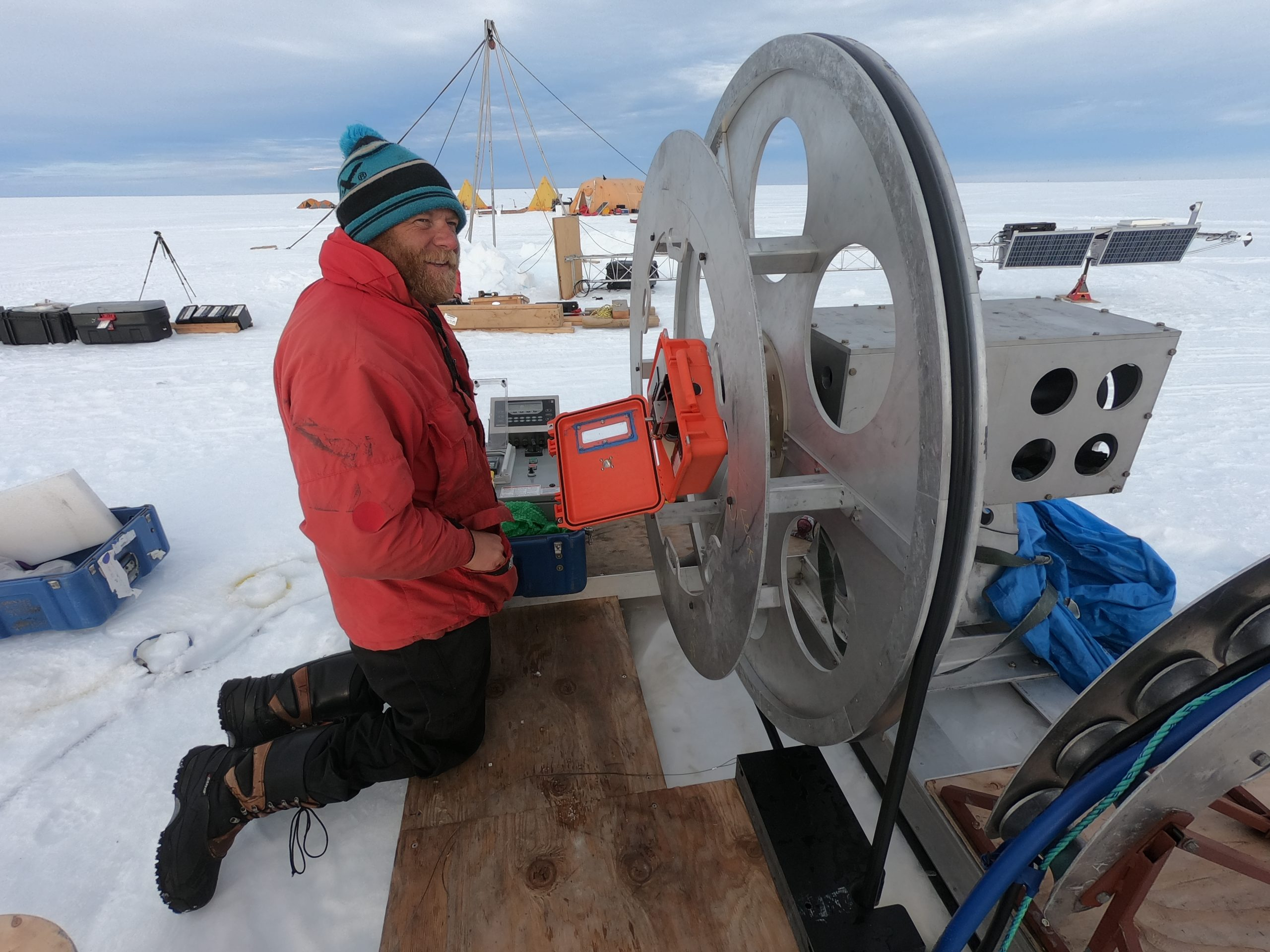 Martin Truffer, a glaciologist from the University of Alaska Fairbanks, monitors the hot water drill as it melts a narrow portal through the 300-meter thick Thwaites Ice Shelf in Antarctica, on December 30, 2019. Photograph by Douglas Fox