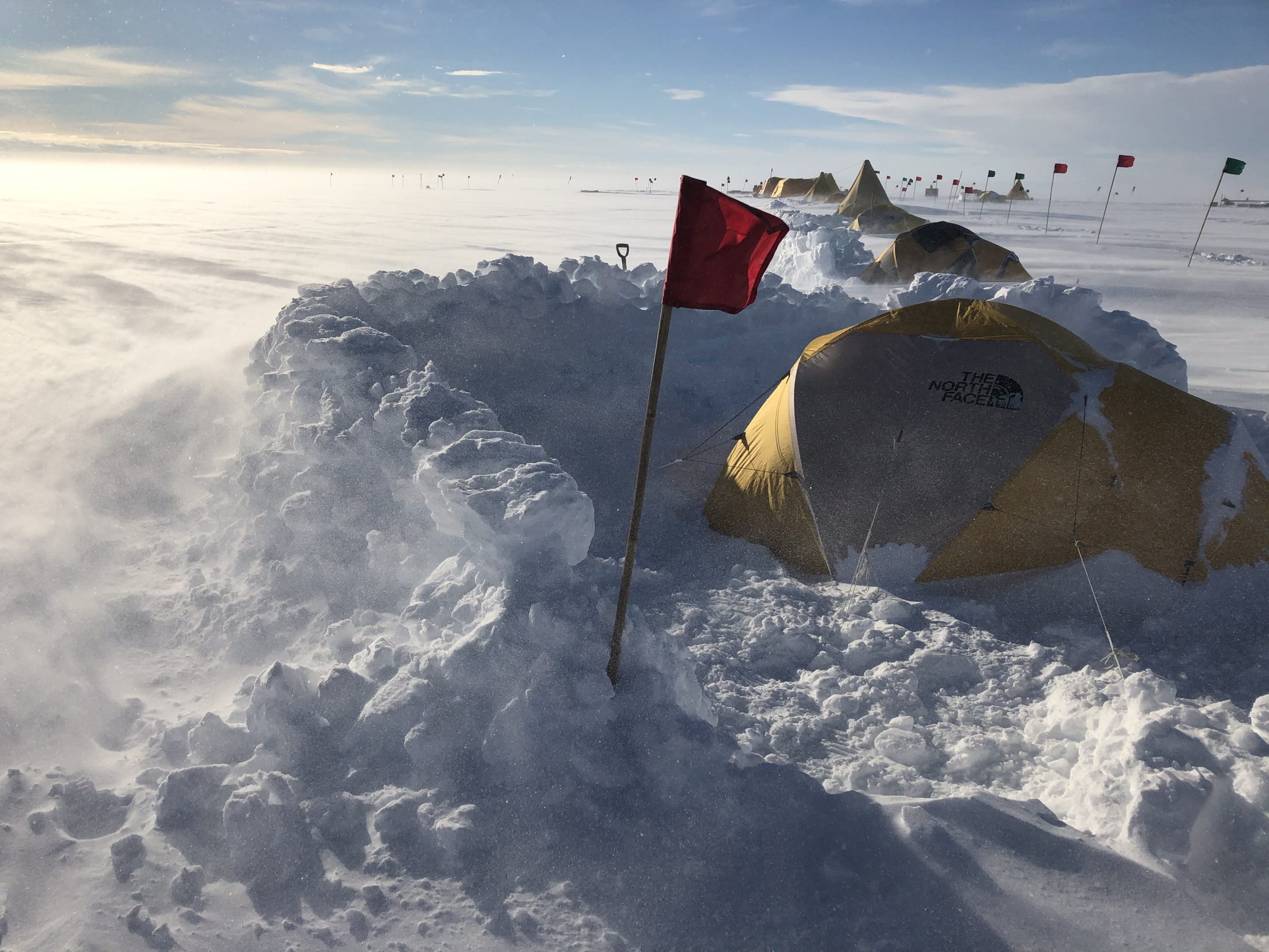 The research team used walls built from snow blocks to protect tents from wind storms on Antarctica's Thwaites Ice Shelf. In order to sleep, one must acclimate to intense 24-hour daylight and the constant din of the flapping tent. Photograph by Douglas Fox